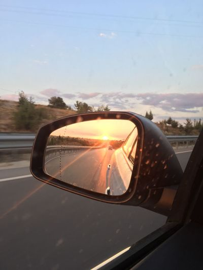 Car Side-view Mirror Transportation Land Vehicle Mode Of Transport Reflection Vehicle Mirror Car Interior Road Sky Window No People Nature Road Trip Sunset Day Close-up Tree Vehicle Part Outdoors