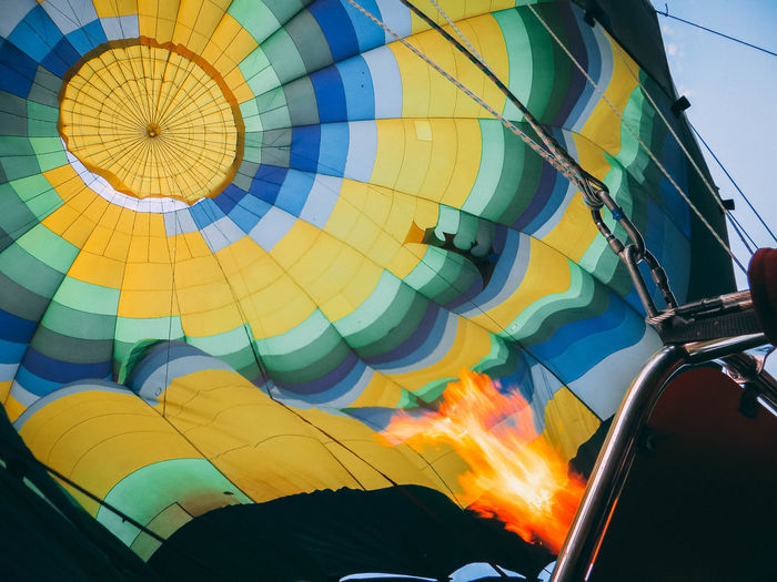 Low Angle View Burning Flame Fire Multi Colored Balloon No People Nature Heat - Temperature Hot Air Balloon Air Vehicle Fire - Natural Phenomenon Sky Transportation Day Close-up Motion Adventure Outdoors Mode Of Transportation Color Nature