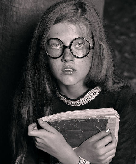 Close-up portrait of girl holding book