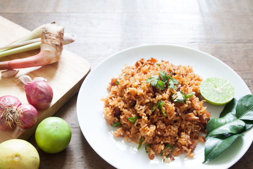 Fried rice on white dish with vegetable, Healthy food Close-up Comfort Food Day Food Freshness Fried Rice Good Taste Healthy Eating Indoors  Leaf Lemon No People Quality Ready-to-eat Spicy Spicy Food Spicy Thai Food Tasty Thai Food Variation Vegetable Wellbeing
