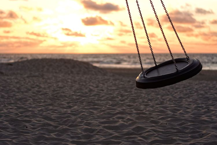 Swing in the Sunset Landscape Landscapes Stock Photo Sunset Sunsets Skyporn Ocean Beach Strand Sonnenuntergang Meer Insel Coastline Sea Sunset Beach Sand Water Hanging Sky Close-up Swing Playground Rope Swing Dusk Horizon Over Water Shore Calm Evening