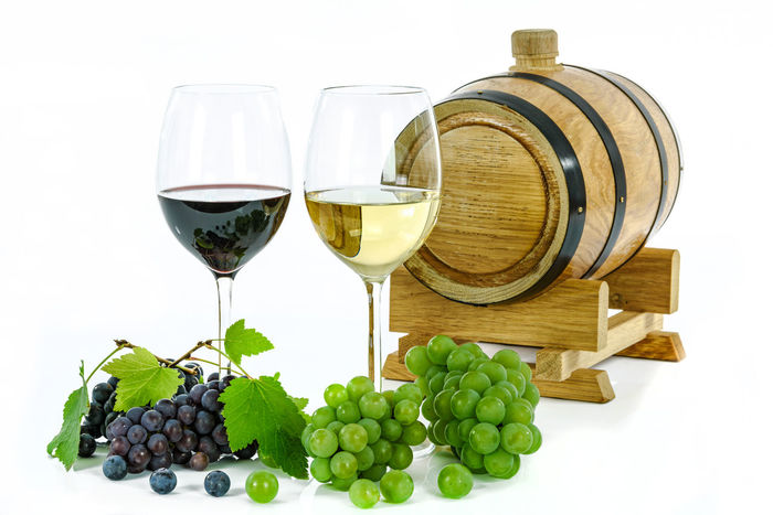 Two types of wine and grapes. Concept of two types of grape wine and wooden barrel isolated on white background. Alcohol Cabernetsauvignon Composition Concept Drink Drinking Glass France Freshness Goblet Grapes Isola Leaf Red Wine Restaurant Studio Shot Two White Background White Wine Wine Wineglass Winery Winetasting Wooden Barrel