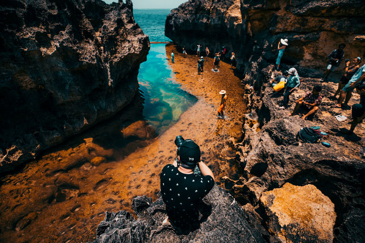 travel Rock - Object Rock Solid Water High Angle View Nature Rock Formation Day Land Sitting Women Sunlight Leisure Activity Real People Sea People Beach Outdoors Bali