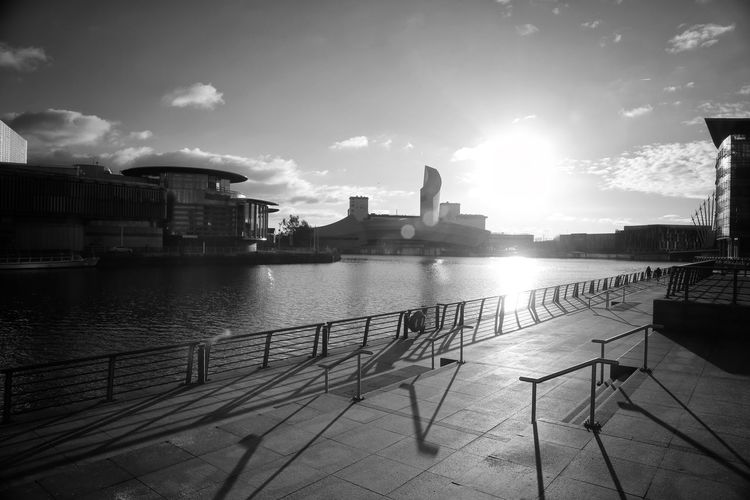 Salford Quays Salford Quays Manchester Bridge - Man Made Structure Millenium Bridge Built Structure Architecture Sky Water Building Exterior Nature Cloud - Sky Railing Building No People City River Sunlight Outdoors Travel Destinations Reflection Travel Transportation Cruise Ship
