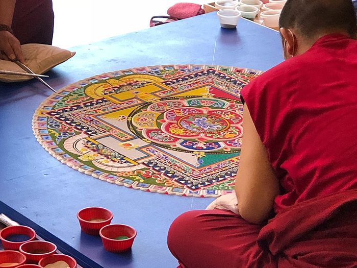 Tibetan Monks Sand Art - 2 Real People Sitting Midsection Lifestyles People Adult Multi Colored High Angle View