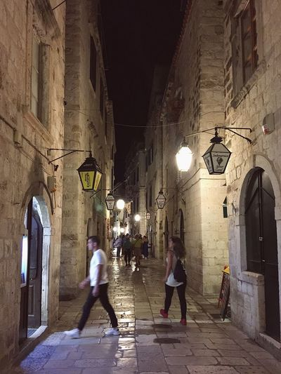 Dubrovnik cobble stone streets by night Architecture Building Exterior Built Structure City Dubrovnik Dubrovnik At Night Full Length Illuminated Lifestyles Lighting Equipment Marmaris Men Night Outdoors People Real People Street Light The Way Forward Walking Wall Lamp Women