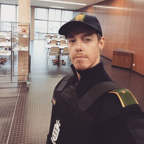 Portrait of man wearing uniform