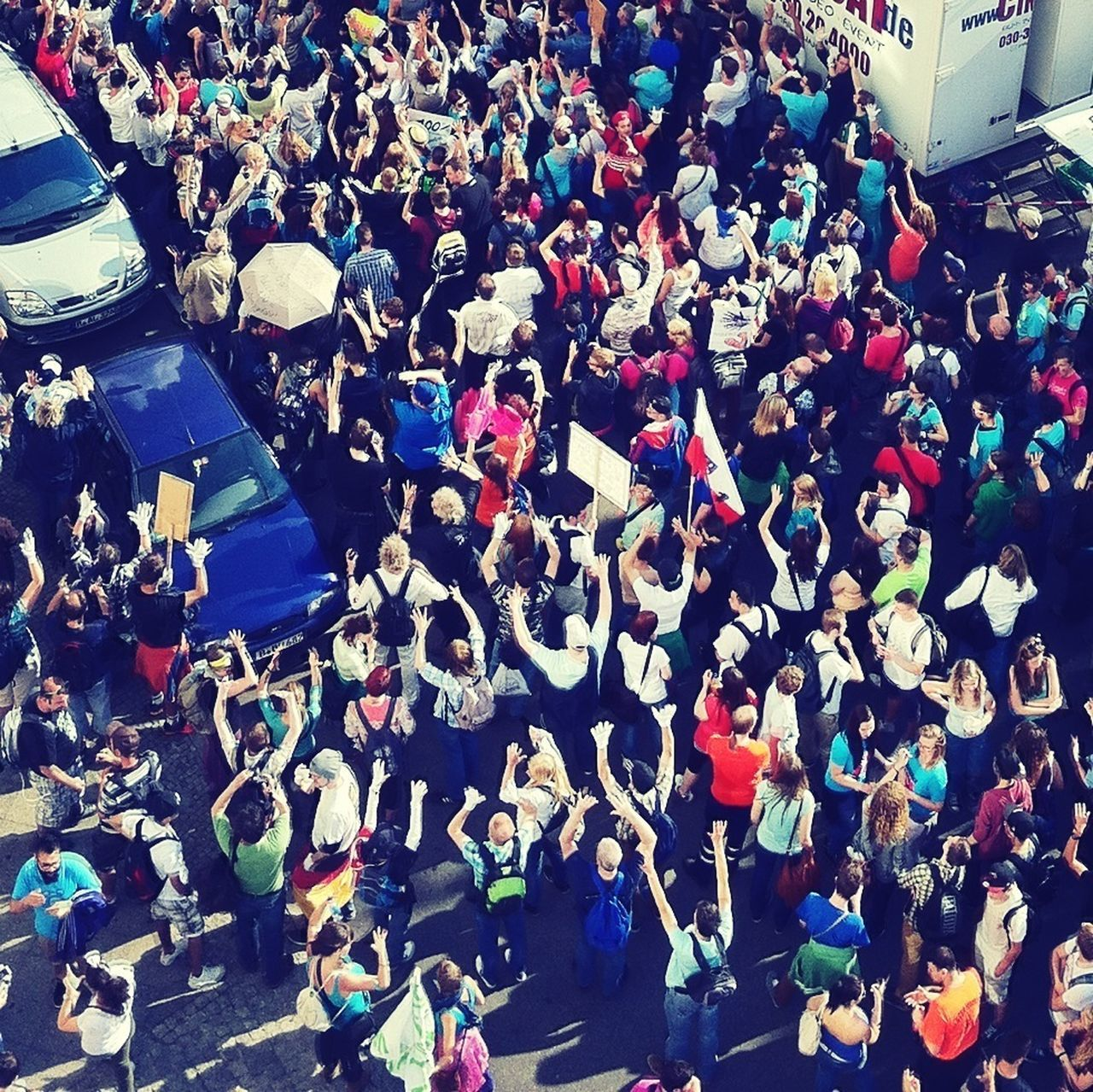 Overhead view of large group of people on road