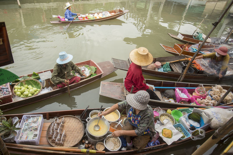 High angle view of venders in boats on floating market