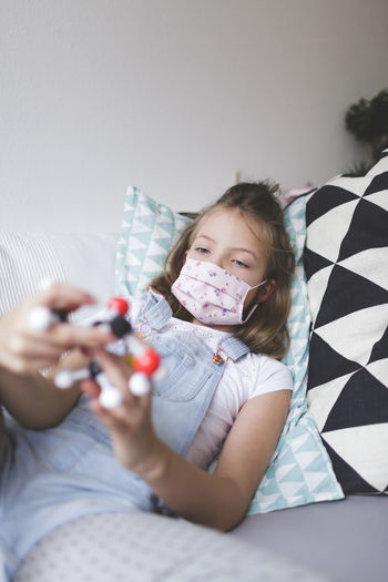 Girl playing with toy at home during quarantine