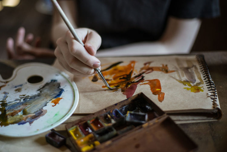 Art Arts Culture And Entertainment Art And Craft ArtWork Artist Paint Painting Painting Art One Person Creativity Skill  Brush Craft Paintbrush Hand Table Human Hand Watercolor Paints Palette Holding Human Body Part