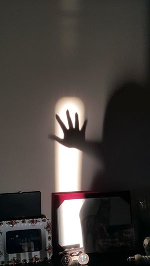 Close-up of hands in the dark