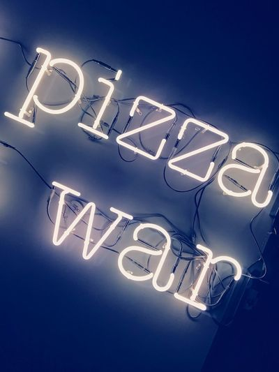 Pizza war Pizzeria Pizza War War Pizza Text Communication Western Script No People Illuminated Capital Letter Number Blue Low Angle View Lighting Equipment Indoors  Night Time Blue Background Connection