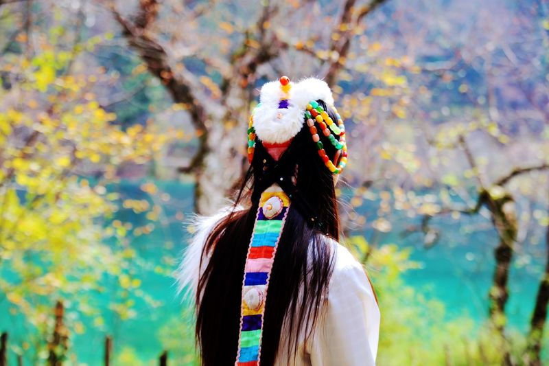 Rear view of woman wearing traditional headdress