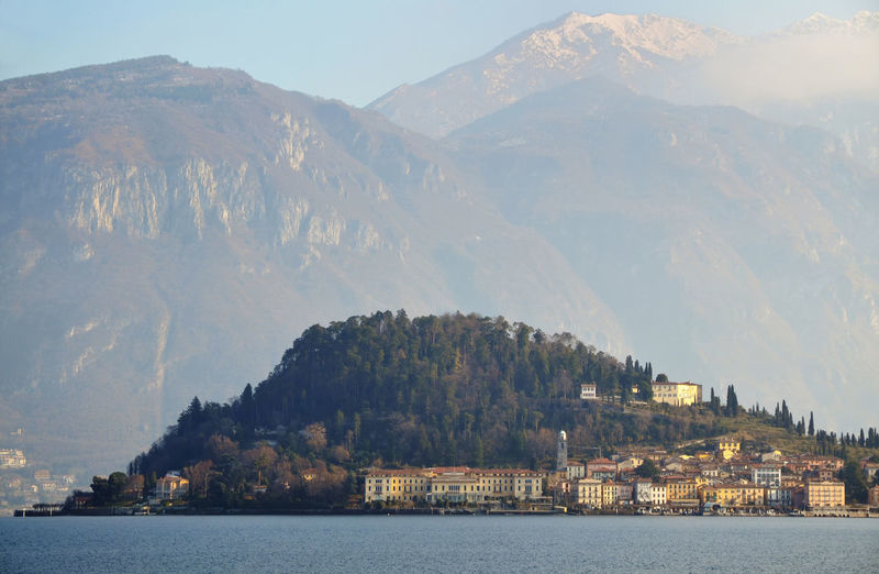 Scenic View Of Lake Como By Village Against Mountains