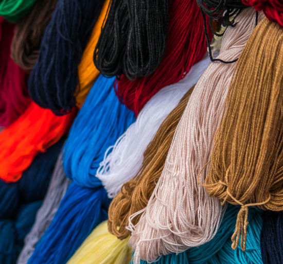 Colored yarn at a street market. Multi Colored Textile Variation Choice Wool Close-up Backgrounds Full Frame No People Market Retail  Material Business Clothing Collection Scarf