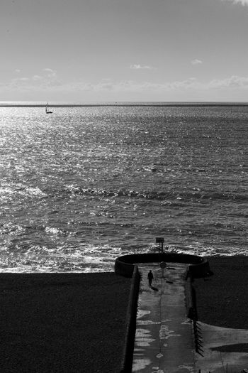 Walking Out To Sea Alone Black & White Beach Beauty In Nature Blackandwhite Horizon Over Water Nature Outdoors Scenics Sea Solitude Tranquil Scene Tranquility Water Wave