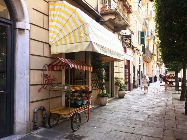 Architecture Building Exterior Built Structure Outdoors Day Awning City No People Shop Store Florist Flower Market Streetphotography Europe Old City City Life City Italy Street Normal Day Quiet Life