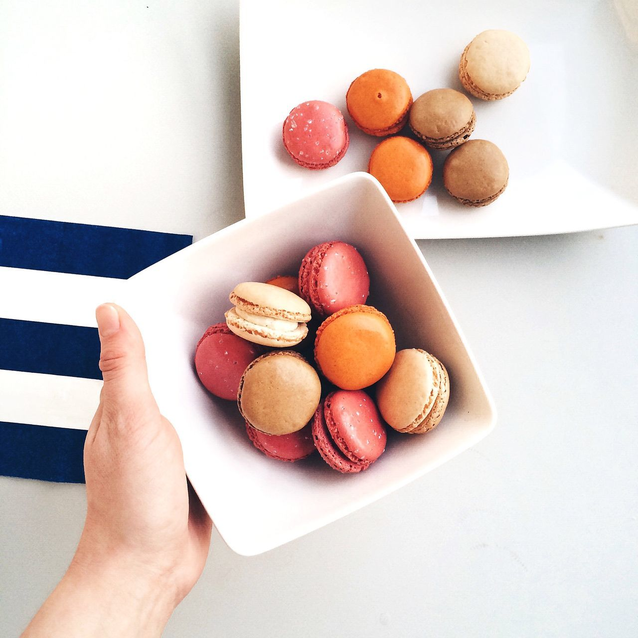 Cropped Hand Of Person Holding Macaroon Bowl