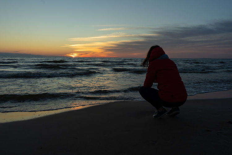 Baltic Sea EyeEmNewHere Baked Eggs Beach Horizon Lifestyles One Person Outdoors Real People Sea Sunset Water Wave