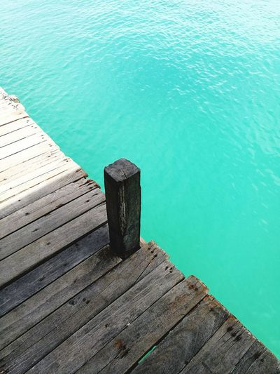 High angle view of wooden pier over sea
