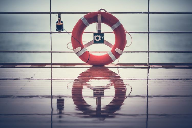 Cruise Ship Wet Deck and the Lifebuoy Ling. Rainy Cruise Weather. Cruise Ship Lifebuoy Ling Circle Day Hanging Indoors  Life Belt Life Saving Lifebuoy Men Real People Reflection Sea Travel Ship Ship Deck Sky