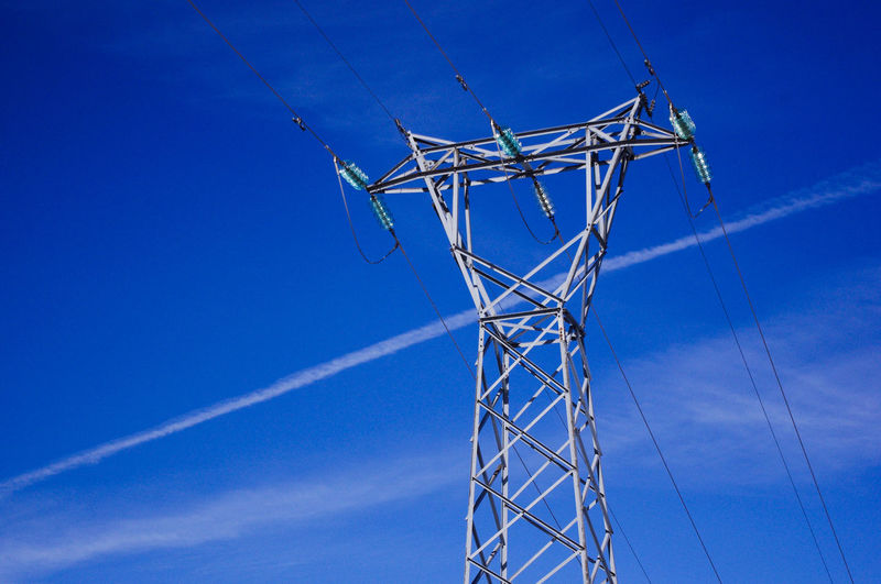 Blue Cable Connection Day Electricity  Electricity Pylon Fuel And Power Generation Low Angle View Nature No People Outdoors Plain Trails Sky Technology Vapor Trail