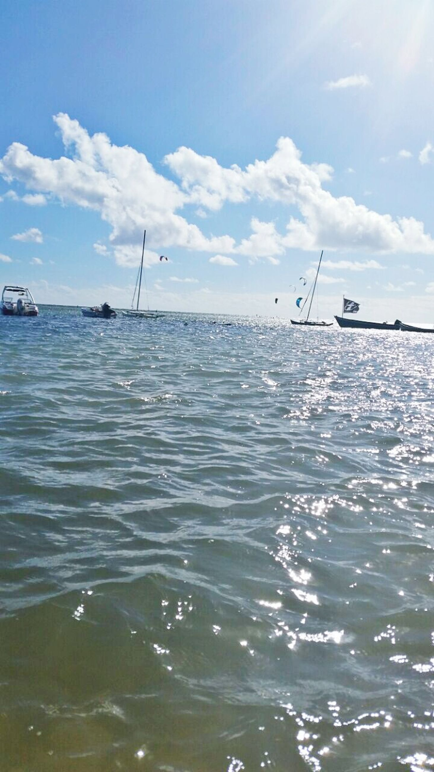 water, sky, sea, waterfront, rippled, tranquility, tranquil scene, scenics, beauty in nature, nature, cloud - sky, nautical vessel, blue, reflection, sunlight, cloud, horizon over water, day, transportation, outdoors