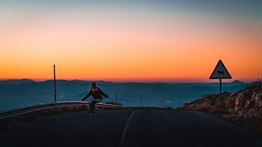 Sunset Sunset One Person Road Scenics Silhouette Full Length Real People Beauty In Nature Nature Lifestyles Sky Transportation Outdoors Mountain Sea Landscape Men Day People Go Higher