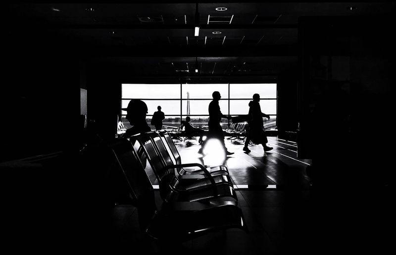 Silhouette people walking in bus