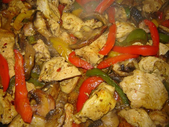 """OMG!!!!!!!, Chicken & Mushroom stir fry"". This is one of my early digital captures, of one of my latest original creations, taken right after removing the fry pan from the stove top & still steaming hot. If there is one gift I received as a child, it was the gift of cooking given to me by my mother from near before I could walk. When it comes to making hot meals, I have two motto's that I always follow. One is that if a delicious hot meal cannot be cooked in ten minutes, then it ain't worth cooking, with exception to roasts or stews. Second, because of my luv for chili's, I definitely like to add extra spices, herbs & hot chili's to my stir fry meals. The extra punch of favors over & above the initial base ingredients to be cooked is a must for my personal palette. This original recipe was so good & mouth watering, that I ended up eating the whole lot in one greedy session, lol. How hot is my level of hot, well if I'm not wiping beads of sweat from my brow, during & after eating, then it isn't hot enough. If you wish to know this delicious recipe, great as a yummy warming winter meal, I might just let you know it, you can PM me. Cooking Cooking At Home Cooking A Meal Cooking Dinner Food Collection Mushrooms Mushrooms 🍄🍄 Tadaa Community Chicken & Mushroom Stir Fry Chicken Stir Fry Chili Hot Close Up Colourful Peppers Cooking Time Delicious Eye4photography  Food Photography Hot Food Hot Tasting Peppers Steaming Hot Food Stir Fry Stir Fry Chicken Streamzoofamily Winter Meal"