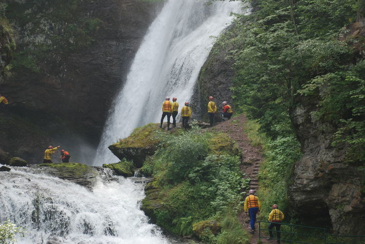 Panoramic view of people by waterfall