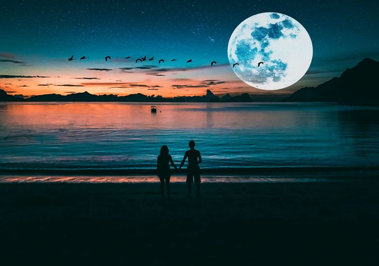 Illuminate Night Moon Planet - Space Astronomy Star - Space Togetherness Sea Beach People Space Sky Child Water Men Full Length Beauty In Nature Galaxy Nature Outdoors Adult