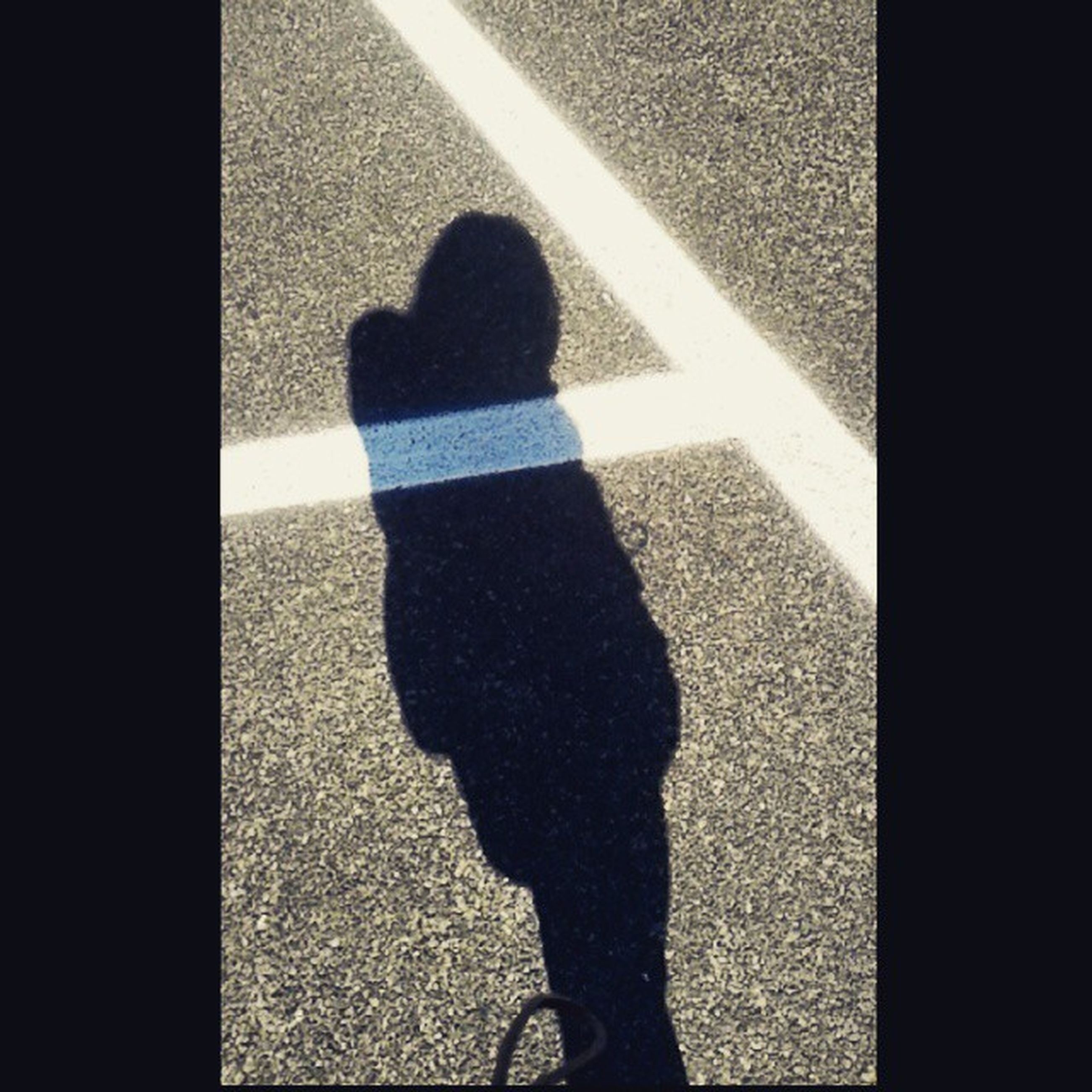 shadow, street, high angle view, lifestyles, sunlight, road, road marking, standing, focus on shadow, walking, men, leisure activity, low section, asphalt, unrecognizable person, day, outdoors, person