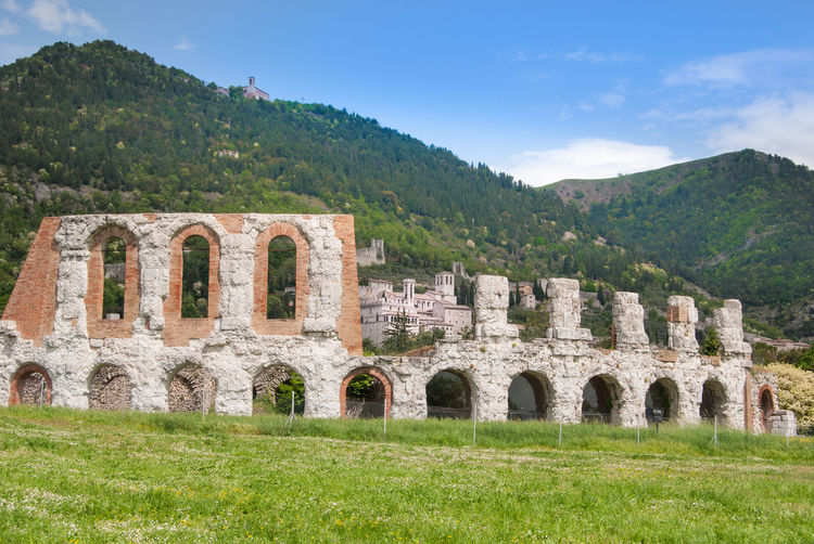 Gubbio, Perugia, Italy Ancient Ancient Civilization Arch Archaeology Architecture Building Exterior Built Structure Day Grass Green Color History Mountain Nature No People Old Ruin Outdoors Plant Roman Theater Ruined Sky The Past Travel Destinations