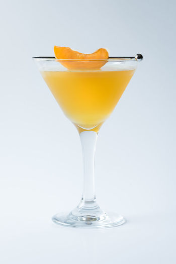 Peach martini Adult Alcohol Beverage Classy Close Up Cocktail Drink Isolated Libation Martini Orange Peach Sophisticated