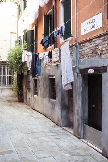 Architecture Building Building Exterior Built Structure City Cleaning Clothesline Clothing Communication Day Drying Hanging House Laundry No People Outdoors Residential District Text Textile Venice Window