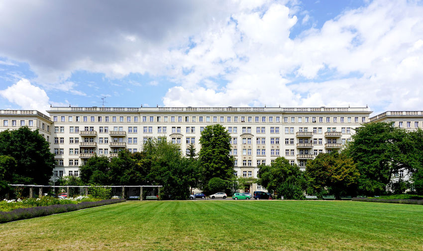 Buildings in the Frankfruter Allee, Berlin Cloud - Sky Sky Building Exterior Plant Built Structure Architecture Tree Nature Grass Day City Green Color Park Outdoors Park - Man Made Space Building Growth Land No People Frankfurter Allee Stalinallee DDR