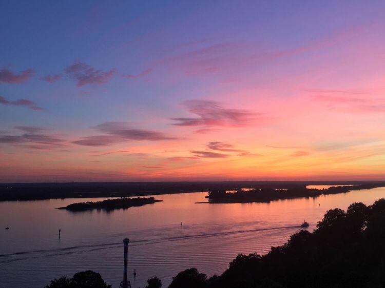 Sunset over the river Elbe Scenics - Nature Sea