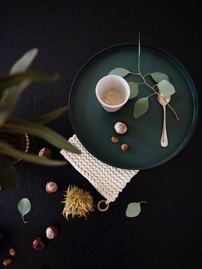 High Angle View Directly Above Still Life Black Background Coffee On The Table Table No People Flower Eukalyptus Ceramic Ceramics Chestnuts Autumn Table Setting At Wedding Table Setting Easter Autumnal Season