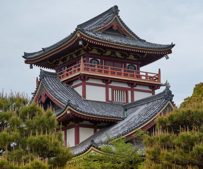 Low angle view of japanese castle against sky