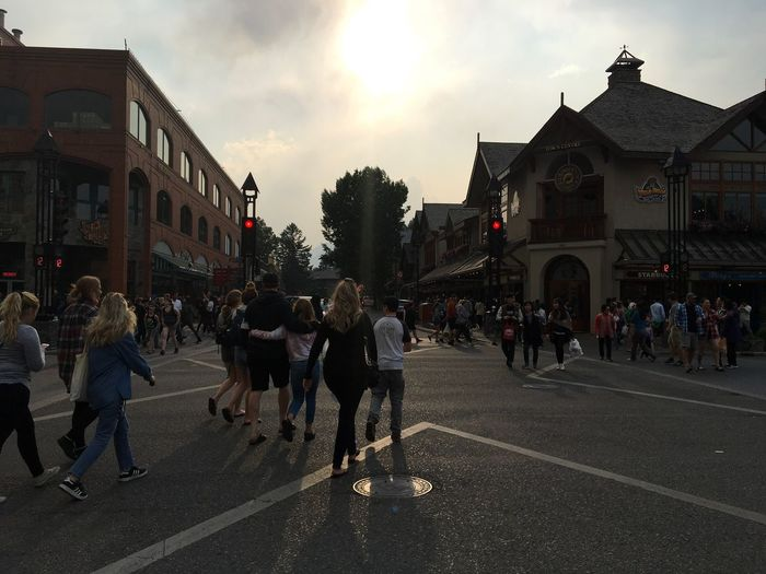 Adventures In The City Group Of People Crowd Large Group Of People City Architecture Real People Building Exterior Street Built Structure Sky Men Lifestyles Transportation Road Cloud - Sky Women Adult City Life Nature City Street Banff