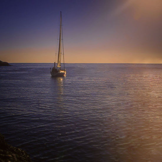 Sailboat In Sunset At Anchor Horizon Over Water Sailing Sea Sea And Sky Sunset Tranquil Scene Water