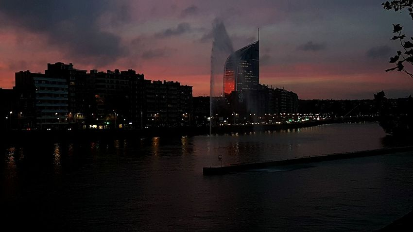Last night Skyscraper Architecture Night Sky Urban Skyline Beautiful Sky Beautifullcolors Fire Travel Sunset No People Outdoors Travel Destinations Downtown District Modern City Cityscape Light And Shadow Luik Bynight Vew From My Eyes Relaxing