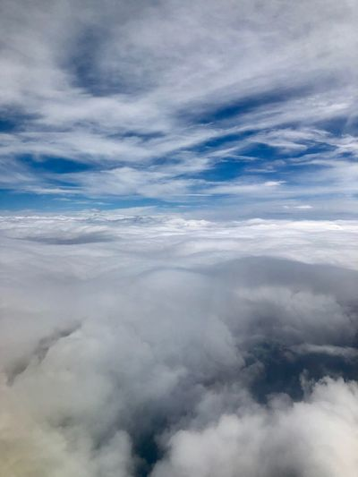 Between the Clouds Flight Home IPhoneography Cloud - Sky Sky Cloudscape Nature Dramatic Sky Beauty In Nature Tranquility Atmospheric Mood Scenics Backgrounds No People Sky Only Outdoors Blue Tranquil Scene Aerial View Ethereal Day Space Above