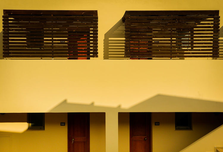 Hotel Room Hotel Door Light And Shadow Architecture Exterior Facade Colours Facade Detail Fassade Building Building Exterior Yellow Architecture Photography Architecturephotography Architecture Colourful Colour Blocking The Graphic City