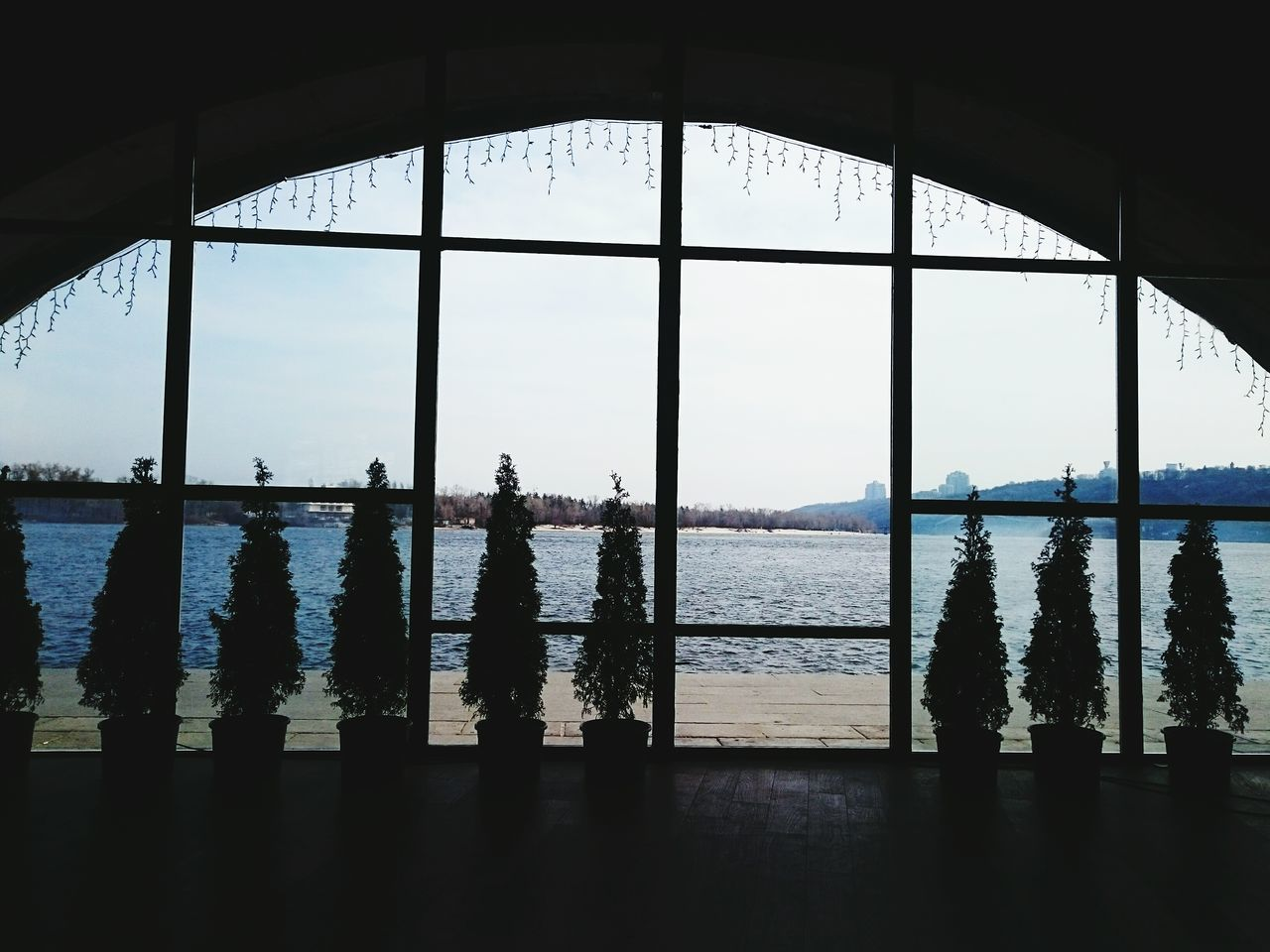 window, water, indoors, sea, day, real people, sky, silhouette, nature, men, standing, tree, architecture, beauty in nature, people