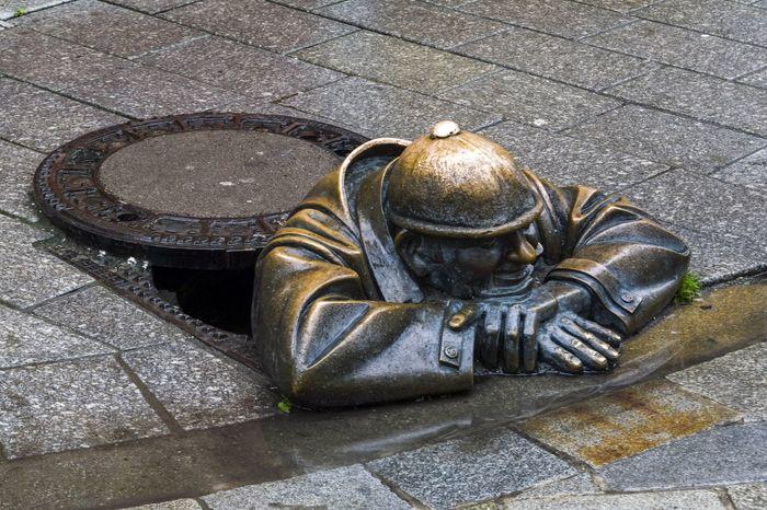 Bratislava Bratislava, Slovakia Bronze Bronze Statue City Cover Europe Excursion Hands HEAD Humour Manhole  Men Metal No People Plumber Sculpture Sewerage Hatchway Sidewalk Statue Tourism Tourist Destination Travel Travelling