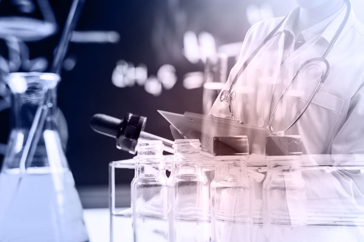 Digital composite image of scientist working in laboratory