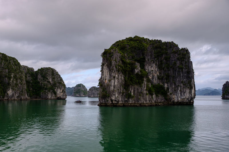 Halong Bay Cruise, Vietnam. Halong Bay  Vietnam Beauty In Nature Cloud - Sky Cruise Day Emerald Fishing Boat Karst Limestone Mountain Nature No People Ocean Outdoors Rock - Object Rock Formation Scenics Sea Seascape Sky Tranquil Scene Tranquility Water Waterfront